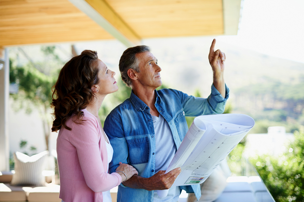 Couple looking at renovation blueprints