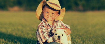 Boy on the farm with his dog