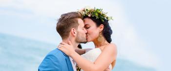 Wedding couple kissing on beach