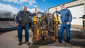 D&D Drilling owners in front of machinery