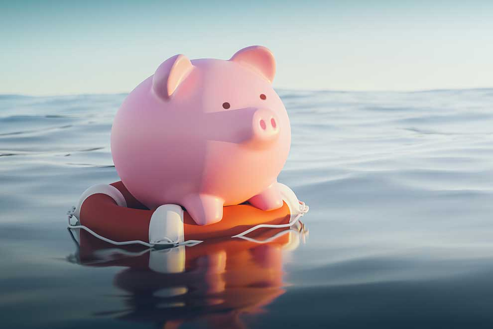 Piggy bank on a life preserver