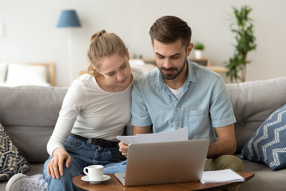Couple looking a computer